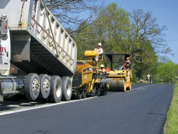 A Sharpe Bros. paving crew in action on Guilford County roads.