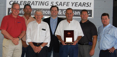 "Sharpe Bros. VP Ivan Clayton holds a plaque from Steve Beals with Travelers, far right, marking five years with no ""lost time"" incidents. Also shown are Vecellio Group VP Safety John West, Sharpe Division Safety Manager John Riley Jr., Vecellio & Grogan President Bill Medcalf, Vecellio Group VP Michael Vecellio and VP Safety Mark Ligon. (Photo by Gloria Fields)"