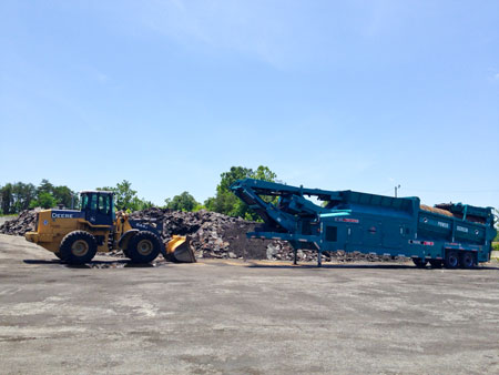 Sharpe Bros. runs an asphalt shingle recycling operation in Greensboro, NC.